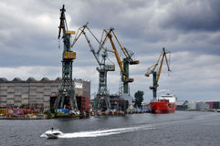 Port cranes standing along the shore of the Baltic Sea. Royalty Free Stock Photo