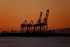 Port cranes in the sunset Stock Photo