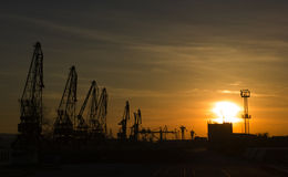 Port cranes on sunset Royalty Free Stock Images