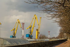 Port cranes in the Vyborg at spring Royalty Free Stock Photo