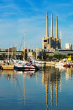 Port de Badalona with chimneys abandoned power plant in backgrou Royalty Free Stock Photo