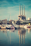 Port de Badalona with chimneys abandoned power plant in backgrou Stock Image
