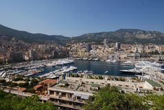 Port de Fontvieille, city, marina, urban area, sky. Port de Fontvieille is city, sky and sea. That marvel has marina, water and cityscape and that beauty stock images