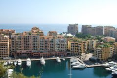 Port de Fontvieille, city, marina, waterway, urban area. Port de Fontvieille is city, urban area and water. That marvel has marina, sea and residential area and stock images