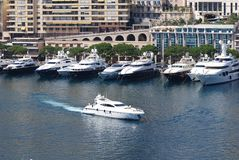 Port de Fontvieille, marina, boat, water transportation, waterway. Port de Fontvieille is marina, waterway and yacht. That marvel has boat, passenger ship and royalty free stock image