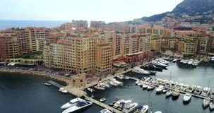 Port de Fontvieille in Monaco. Azur coast. Bay with a lot of luxury yachts stock footage