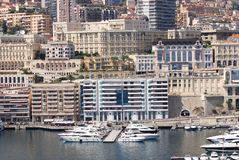 Port de Fontvieille, Monte-Carlo, city, urban area, water transportation, marina. Port de Fontvieille, Monte-Carlo is city, marina and skyline. That marvel has royalty free stock photography