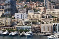 Port de Fontvieille, Monte-Carlo, marina, city, urban area, water transportation. Port de Fontvieille, Monte-Carlo is marina, water transportation and skyline royalty free stock images