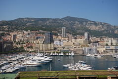 Port de Fontvieille, Monte-Carlo, town, cityscape, city, landmark. Port de Fontvieille in Monte-Carlo where you can see the town, it`s urban area and the port Stock Images