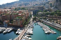 Port de Fontvieille, waterway, city, marina, urban area. Port de Fontvieille is waterway, urban area and harbor. That marvel has city, water and sky and that stock photos