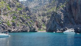 Port de Sa Calobra, Mallorca, Spain. The bay with turquoise sea from the boat. Summer time stock video