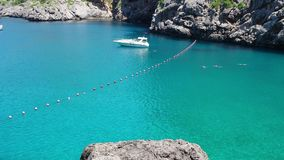 Port de Sa Calobra, Mallorca, Spain. The bay with turquoise sea on the path that leads to the beach and the canyon. Summer time stock video
