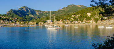 Panoramic view of boats moored in a bay. Panoramic view of boats moored in the bay at Port de Soller, Majorca Spain in the evening sunlight (21x9&#x29 Stock Photo