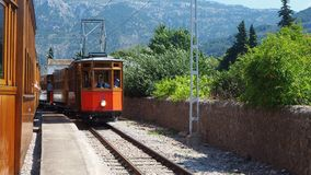 The old electric tram running between Soller and the downtown of Port de Soller stock footage