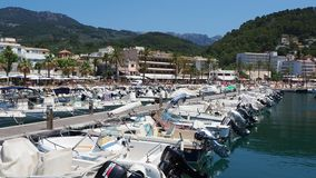 Port de Soller, Mallorca, Spain. The port during the summer season. Many boats at the harbor stock footage
