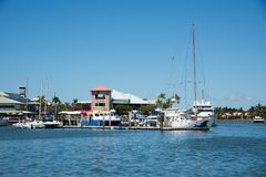 Port Denarau. FIJI-NOVEMBER 27,2016: Harbour waterfront buildings and moored sailboats in the Pacific Ocean inlet in , Fiji Stock Photo