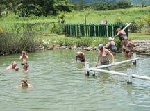 Hot Spring Experience. PORT DENARAU, FIJI-NOVEMBER 27,2016: Tourists bathing in natural thermal hot spring in the tropical landscape of Port Denarau, Fiji Royalty Free Stock Photography