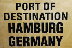 Port of destination Hamburg Germany printed on wooden transport box royalty free stock photography