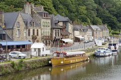 Port of Dinan. Idyllic scenery at the port of Dinan, a town in Brittany, France. It is located at the river Rance Stock Photography