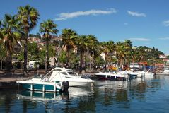 Port dof Lavandou. Port of Lavandou in France with palm trees Stock Photos