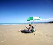 Port Douglas. Relaxing under a beach unbrella in Port Douglas Royalty Free Stock Image