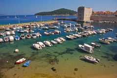 Port of Dubrovnik with City Wall and Boats Royalty Free Stock Photo