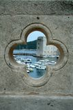 Port in Dubrovnik in the hole. View on the port in Dubrovnik from the hole in bridge - the wall is sharp and the port is blurred Royalty Free Stock Photography