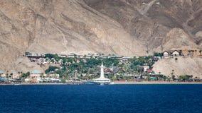 Eilat Aquarium Observatory. Port of Eilat, Israel marine observatory and aquarium with resort and landscape background stock images