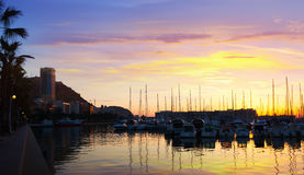 Port   and embankment in dawn. Alicante Royalty Free Stock Photos