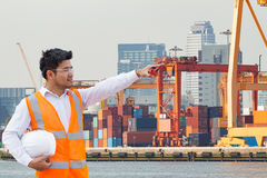 Port engineer standing in front of the industrial harbor Stock Images