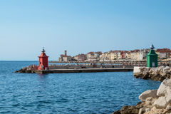 Port entrance of Piran with lighthouse, Slovenia Royalty Free Stock Photo
