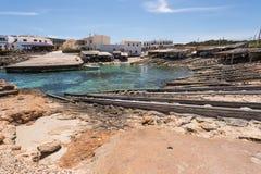 Port för Es Caló i Formentera fartygjärnvägar Royaltyfria Bilder