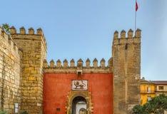 Port för lejon` s i Alcazar av Seville, Spanien arkivfoto