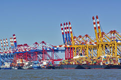 Port facilities with cranes and freight ships Stock Images