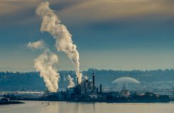 Port Factory Steam. Steam rises from a factory at the Port of Tacoma royalty free stock images