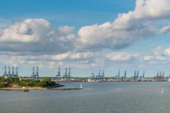 Port of Felixstowe, England, UK. Felixstowe, Suffolk, England, UK - May 23, 2017: Panoramic view of the Port of Felixstowe with some cranes, containers and a Stock Photography