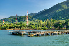 Port ferry boat with concrete ferry pier,Koh Chang, Thailand. Stock Images