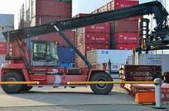 Unloading the container in port Stock Photos