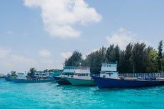 Port full of small fishermen`s and cargo boats located at Villingili island Stock Photos