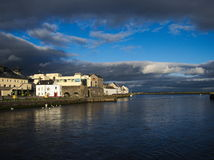 Port of Galway. /Ireland with clouds houses and sea Stock Photos