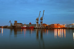 Port of Gdansk at dusk. Ship tanker supplying fuel to other vessels Royalty Free Stock Photo