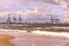 Port of Gdansk. View of the northern Port in Gdansk Poland, visible shore of sea and cloudy sky royalty free stock photos