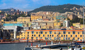 Port of Genoa Genova, Italy. View of the old town. Port of Genoa Genova, Italy. View from the sea towards the old town on a summer sunny day. Marina harbor and royalty free stock photo