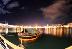 Port of Genoa in night. Tuh port of genoa with the lantern, symbol of the city Royalty Free Stock Photography