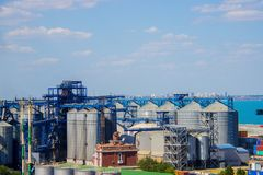 Port grain elevator. Industrial sea trading port bulk cargo zone grain terminal Royalty Free Stock Photos