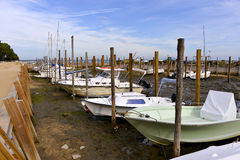 Port of Grand Piquey in France. Boats at low tide in the port of Grand Piquey, village is a located on the shore of Arcachon Bay, in the Gironde department in Royalty Free Stock Photos