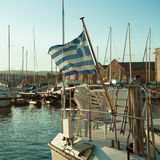 Port, the Greek flag and boats, impressions of Greece Stock Images