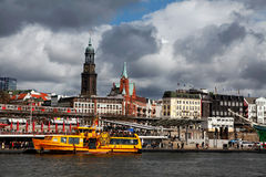 Port of Hamburg. And the Elbe with yellow boat royalty free stock images