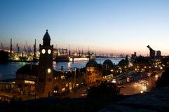 "Port of Hamburg. Landungsbrücken (""Jetties""), in St. Pauli quarter. View of the old harbor of Hamburg in evening Royalty Free Stock Photo"
