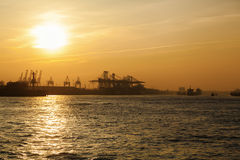 Port of Hamburg, Germany, at sunset Royalty Free Stock Images